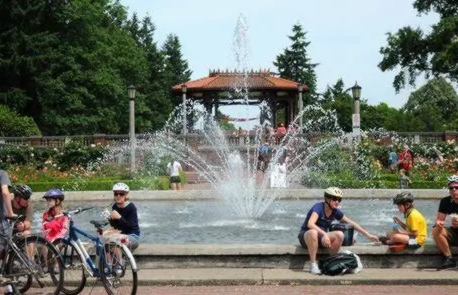 Visitors on bikes at Peninsula Park Rose Garden
